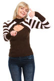 Smiling senior woman showing call me gesture Royalty Free Stock Photography