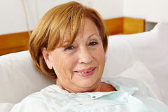 Smiling senior woman in sleeping Royalty Free Stock Photography