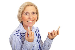 Smiling senior woman with tooth brush Stock Images