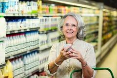 Smiling senior woman using smartphone Stock Photos
