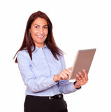 Smiling senior woman working on her tablet pc Stock Photos