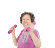Smiling senior woman working out with dumbbells Royalty Free Stock Photo