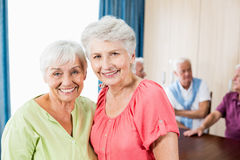 Smiling senior women looking at camera. In a retirement home Royalty Free Stock Images