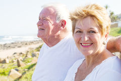 Smiling seniors. Happy smiling seniors couple on beach on a sunny day Stock Photo