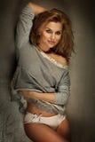 Smiling sensual blonde lady posing. Royalty Free Stock Photos