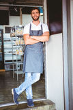 Smiling server in apron arm crossed Stock Photos