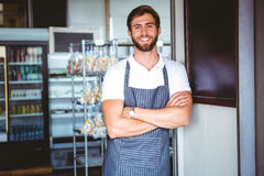Smiling server in apron arm crossed Royalty Free Stock Photo
