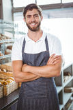 Smiling server in apron arm crossed Royalty Free Stock Photography