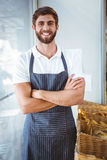 Smiling server in apron arm crossed Stock Images