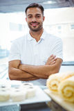 Smiling server in apron arm crossed Royalty Free Stock Images