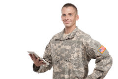 Male soldier holds a tablet. Smiling serviceman holds a tablet Stock Photography