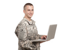 Serviceman holds a laptop computer Royalty Free Stock Photography