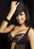 Smiling sexy beauty in lingerie and hat Stock Photography