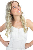 Smiling sexy blonde hands on hips looking up Royalty Free Stock Photo