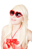 Smiling sexy blonde in heart-shaped glasses Stock Photo