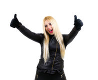 Smiling sexy blonde with thumbs up. Smiling sexy blonde dressed in black with thumbs up. White background Stock Photography