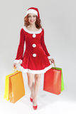 Smiling Sexy Caucasian Ginger Santa Helper Girl with Plenty of C Stock Photos