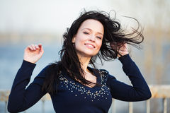 Smiling sexy girl with long black hair Royalty Free Stock Photos