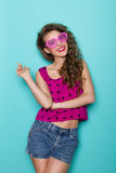 Smiling sexy girl in pink sunglasses Stock Photo