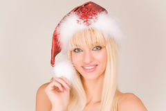 Smiling sexy mrs. Santa. In red hat Stock Image
