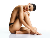 Smiling sexy woman with perfect body on white background. Royalty Free Stock Photography