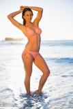 Smiling woman in pink bikini posing Royalty Free Stock Photo