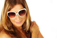 Smiling sexy woman in sunglasses. Smiling sexy young woman wearing sunglasses against a white background with space on the right for text Stock Photography