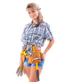 Smiling  sexy young female construction worker isolated on white Royalty Free Stock Photo