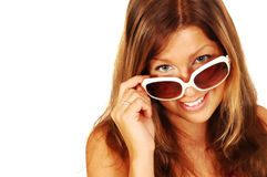 Smiling sexy young woman. Wearing sunglasses against a white background with space on the left for text Stock Images