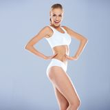 Smiling Sexy Young Woman in White Fitness Outfit Stock Photo