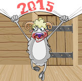 Smiling sheep with a banner 2015. In a wooden house Royalty Free Stock Image