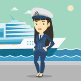Smiling ship captain in uniform at the port. Royalty Free Stock Image