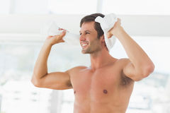 Smiling shirtless man with towel in gym Royalty Free Stock Photography