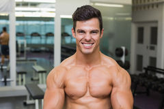 Smiling shirtless muscular man in gym Royalty Free Stock Images