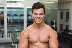 Smiling shirtless muscular man in gym Royalty Free Stock Images