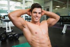 Smiling shirtless muscular man in gym Stock Images