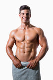 Smiling shirtless muscular man wrapped in white towel Royalty Free Stock Photos