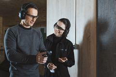 Smiling shooting instructor talking to client. In shooting range stock photos