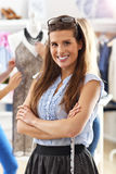 Smiling shop manager in front of her boutique Stock Image