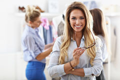 Smiling shop manager in front of her boutique Stock Photo