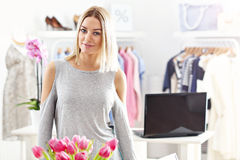 Smiling shop manager in front of her boutique Royalty Free Stock Photo