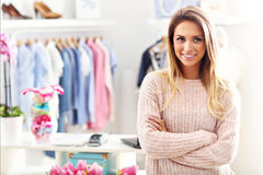 Smiling shop manager in front of her boutique Royalty Free Stock Photos