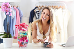 Smiling shop manager in front of her boutique Royalty Free Stock Images