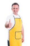 Smiling shopman showing thumb up to you. Or doing like gesture on white background Royalty Free Stock Photo