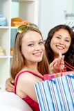 Smiling shoppers Royalty Free Stock Images