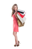 Smiling shopping babe Stock Photo