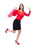 Smiling Shopping bag Woman running. Woman in red running holding shopping Bag over her shoulder isolated on White Stock Image
