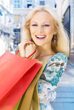 Smiling shopping girl Royalty Free Stock Photo