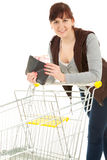 Smiling shopping girl with euro in wallet Stock Photos