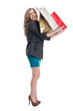 Smiling shopping girl holding bags on her arms Stock Photos